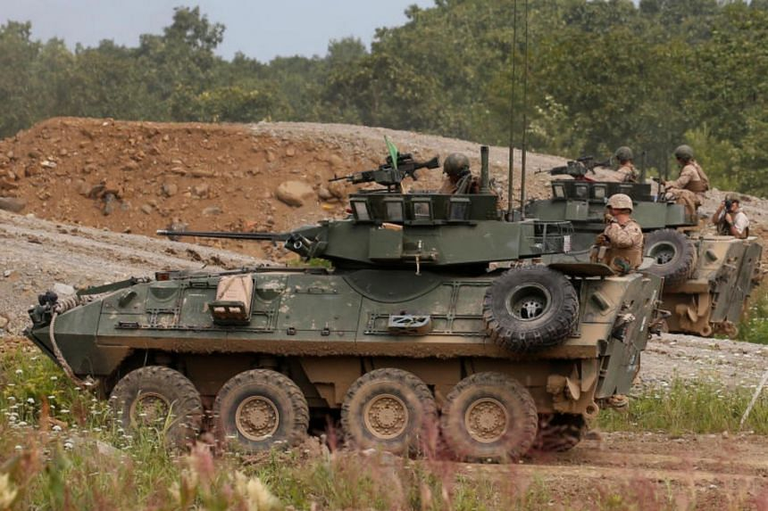 US Marine Corps LAV-25 Light Armoured Vehicles take part in their joint exercise, named Northern Viper 17, with Japan Ground Self Defense Force at Hokudaien exercise area in Eniwa on Aug 16, 2017.