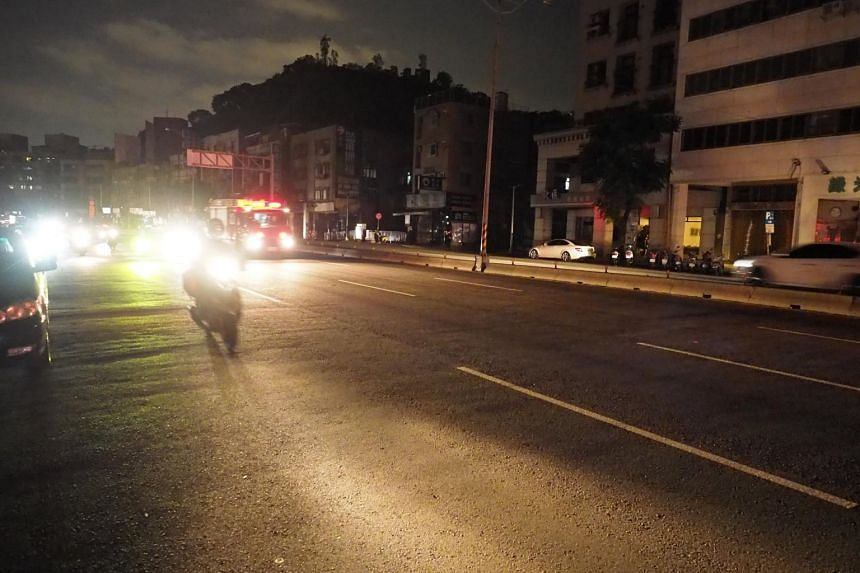Motorists in traffic during a power outage on a street in Taipei, Taiwan, on Aug 15, 2017.