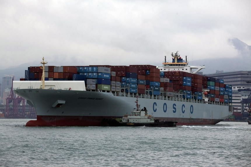 A tug boat pushes the 334-meter-long China Ocean Shipping Company's (COSCO) Prince Rupert container ship in the Kwai Tsing Container Terminals, in Hong Kong.