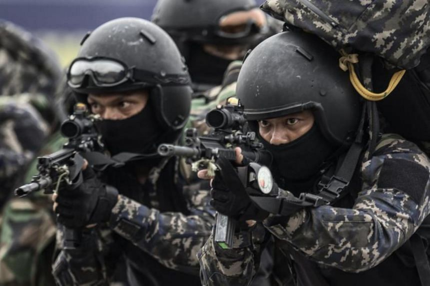 Members of the Royal Malaysian Police Special Tactical Unit take part in a security drill simulating the rescue of hostages. This is to prepare for the upcoming SEA GAMES in Kuala Lumpur, Malaysia, on Aug 3, 2017.