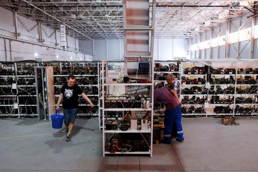 Russia's crypto-businessman Dmitry Marinichev's virtual currencies mining farm operates in a former Soviet-era car factory warehouse in Moscow.