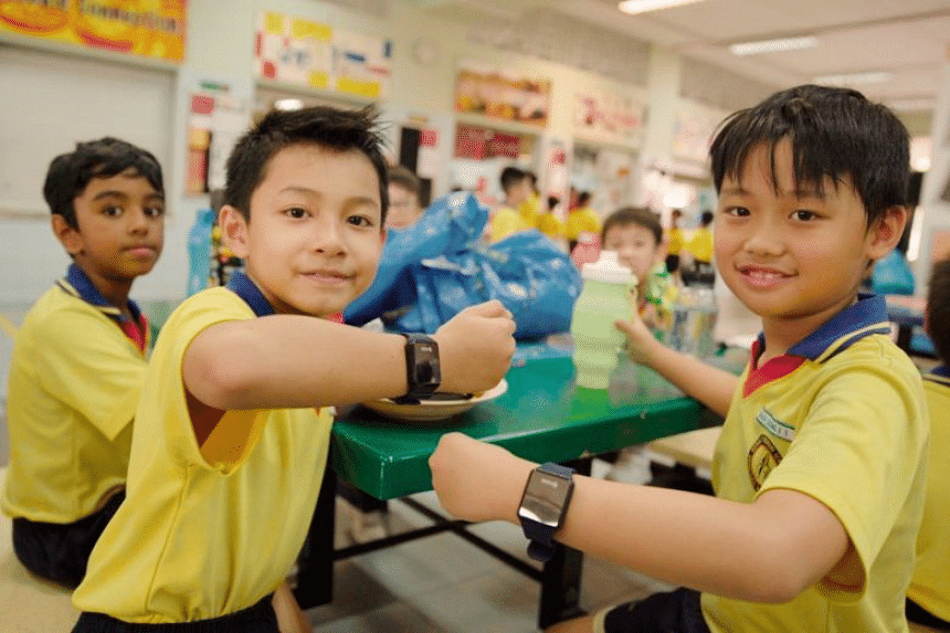 Admiralty Primary School pupils show off their POSB Smart Buddy watches.