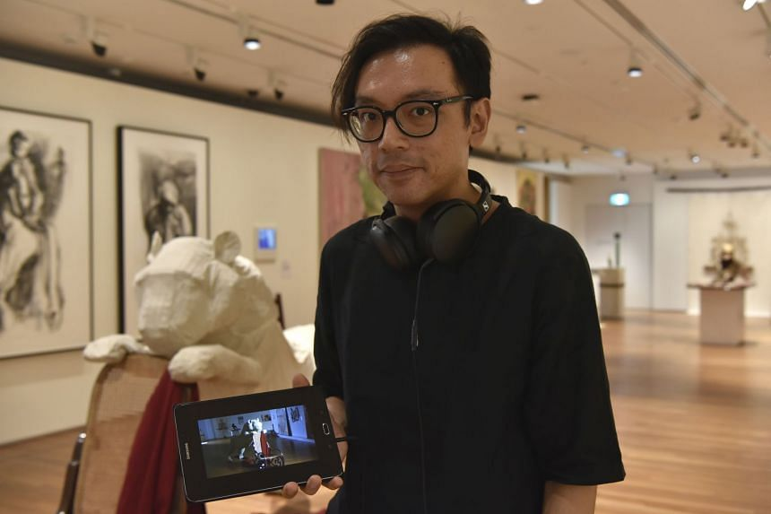 Artist Ho Tzu Nyen's (above) three video works are in response to artworks at the National Gallery Singapore depicting tigers, such as Boschbrand (1849) by Raden Saleh.