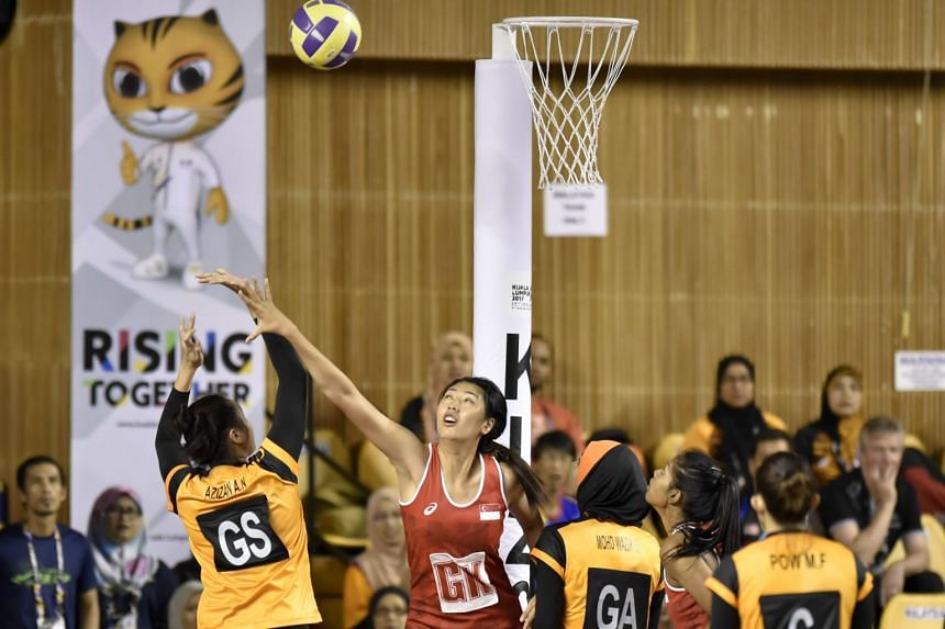 Malaysia beat Singapore 50-37 in the second group stage game.