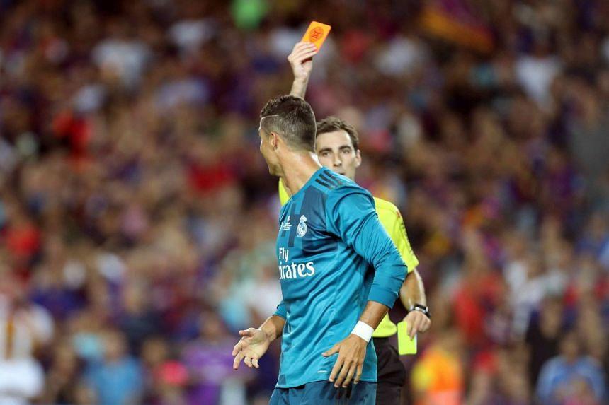Referee Ricardo de Burgos expels Real Madrid's Portuguese striker Cristiano Ronaldo.