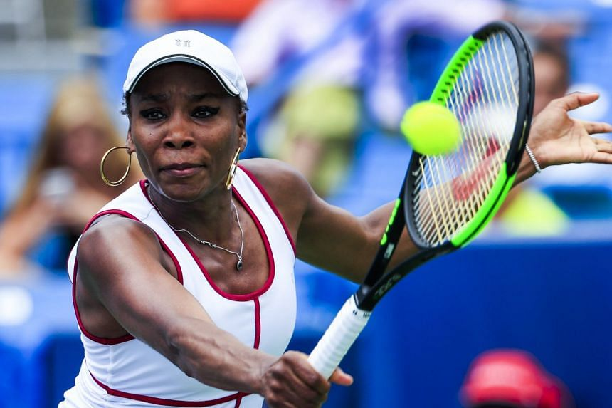 Venus Williams in action against Ashleigh Barty of Australia.