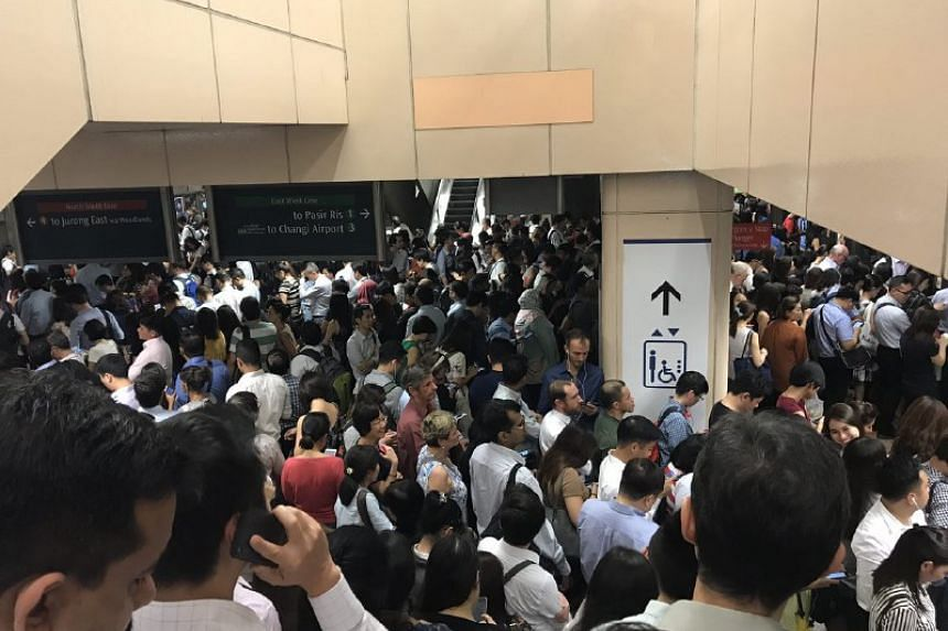 Raffles Place MRT station was packed to the seams on Thursday night.