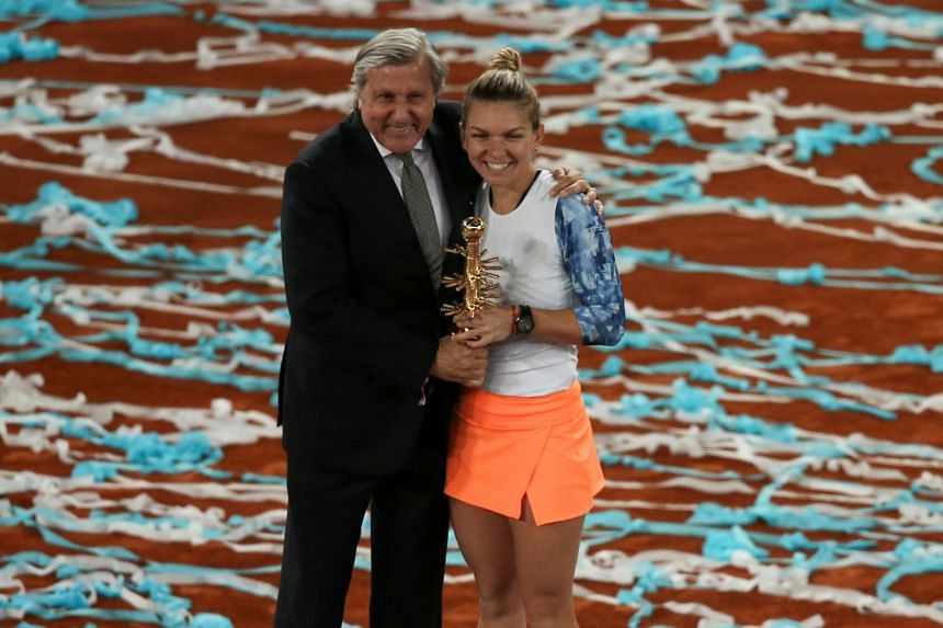 Nastase with Romania's Simona Halep after she won the WTA Madrid Open, in May 2017.