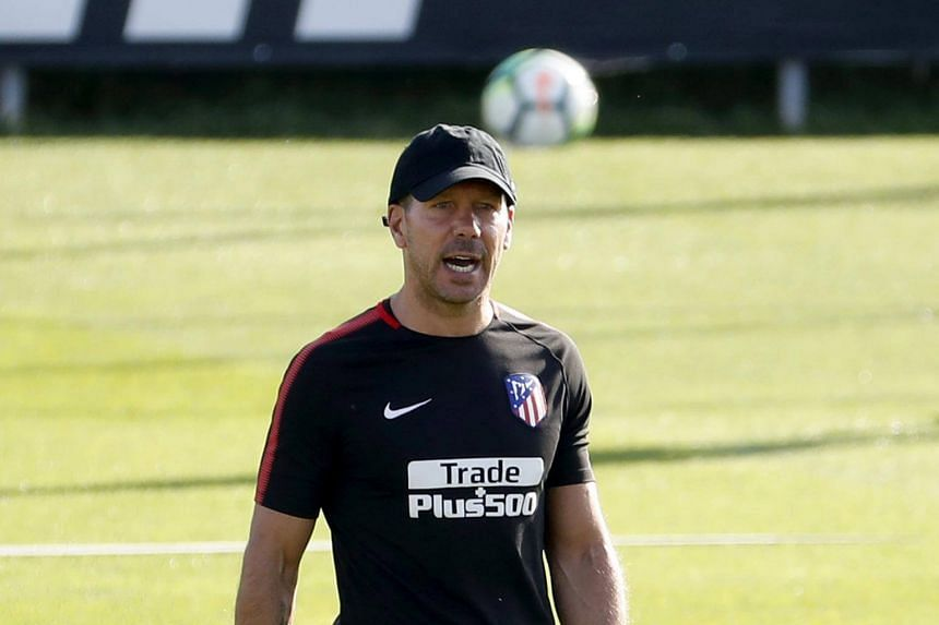 Atletico Madrid's Argentinian head coach Diego Pablo Simeone gives instructions during the team's training session held in Wanda sport city in Majadahonda, on Aug 15, 2017.