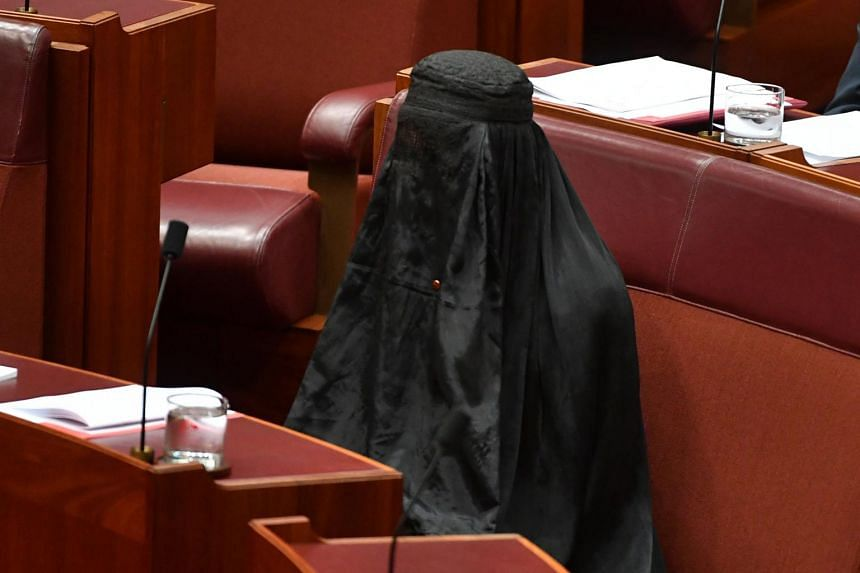 Australian One Nation party leader, Senator Pauline Hanson, wears a burqa in the Senate Chamber at Parliament House in Canberra, Australia, on Aug 17, 2017.
