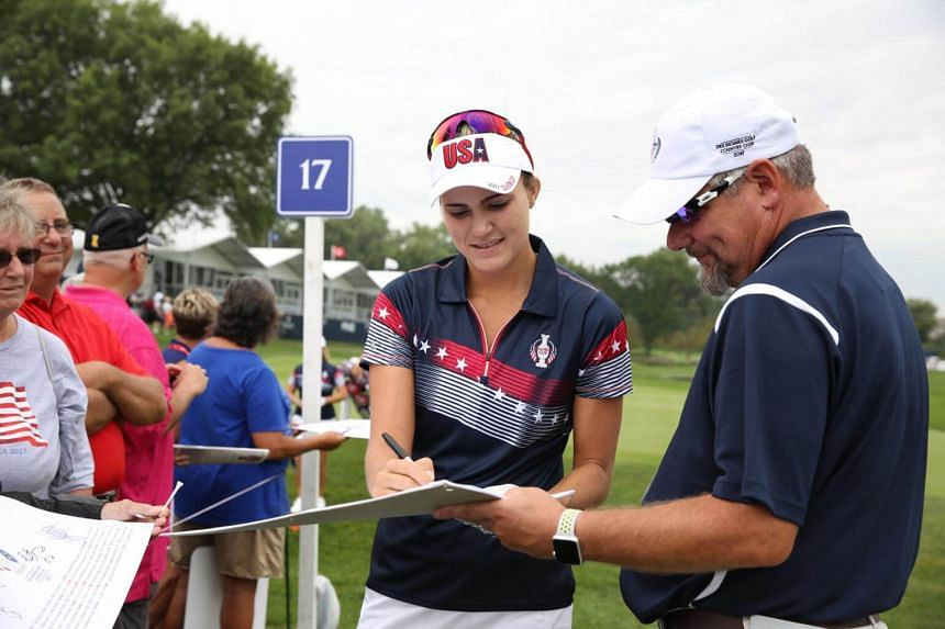 USA golfer Lexi Thompson signs autographs as she walks to the 18th tee during the second practice round for The Solheim Cup at Des Moines Golf and Country Club, on Aug 16, 2017.