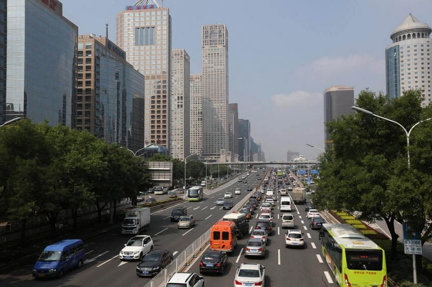 A general view shows vehicle traffic in a main road the central business district (CBD) of Beijing, China, on Aug 14, 2017.