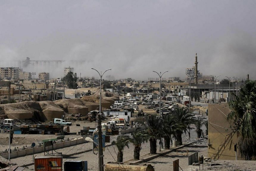 Smoke billows in an eastern area of the embattled northern Syrian city of Raqqa on Aug 15, 2017.