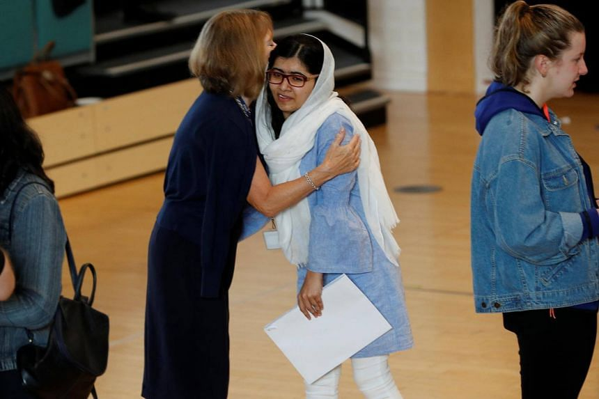 Malala Yousafzai is congratulated after collecting her 'A' level exam results at Edgbaston High School for Girls in Birmingham, Britain, on Aug 17, 2017.