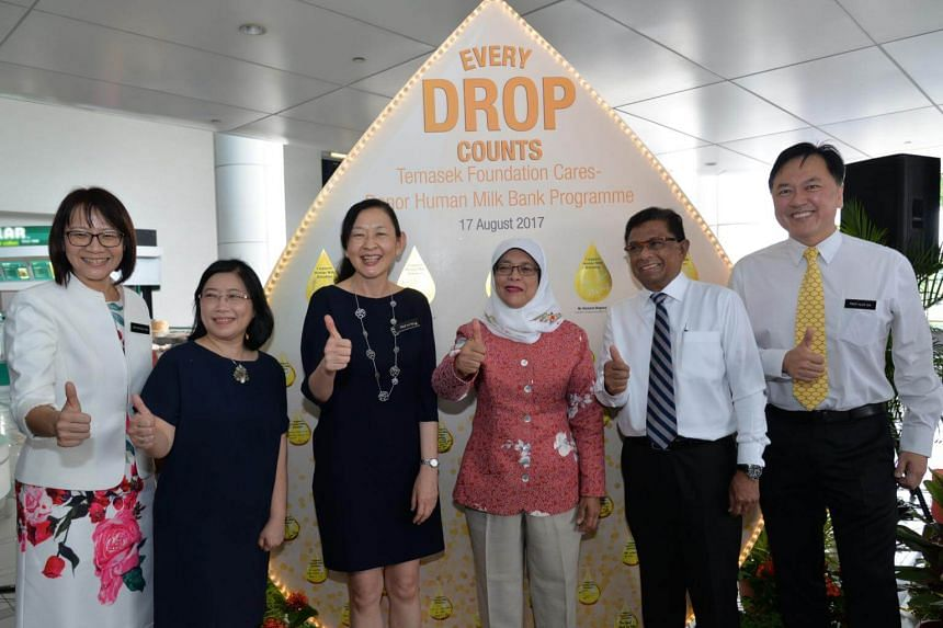 Guest of honour Halimah Yacob and VIPs pledging their support for human milk donation.