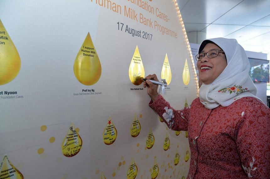 Guest of honour Halimah Yacob pledging her support for human milk donation.