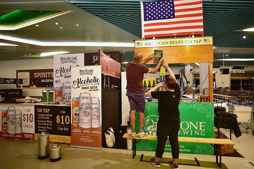 Vendors from Beerstyle Distribution working on their booth at the Marina Bay Cruise Centre in preparation for Beerfest Asia 2017. There will be more than 500 varieties of beers and ciders at the festival.
