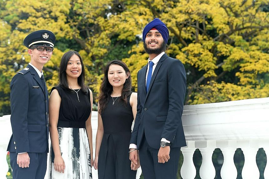 Four of this year's five President's Scholars (from left) Lionel Oh, Cheri Wee, Agatha Sacha Lim Lee and Jasdeep Singh Hundal. They received their awards from President Tony Tan Keng Yam, who spoke about the impact of the constantly changing global e