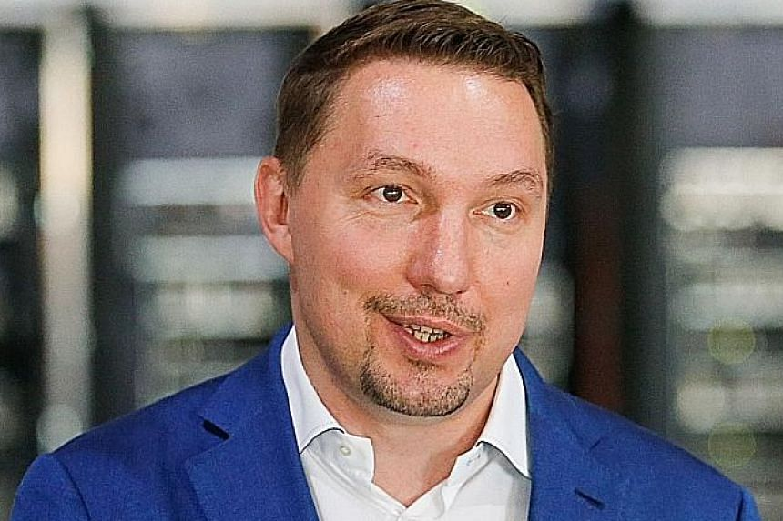 Mr Dmitry Marinichev is one of Russia's leading crypto- businessmen. His virtual currency mining farm operates in a former Soviet-era car factory warehouse in Moscow (right). Mining farms like this represent a growing craze in Russia for bitcoin and