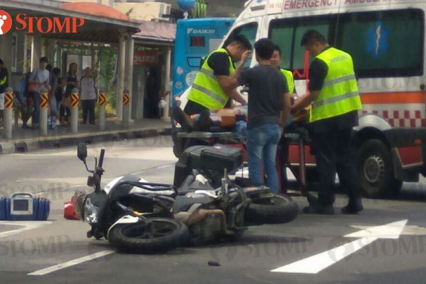 The motorcyclist was taken to Raffles Hospital.