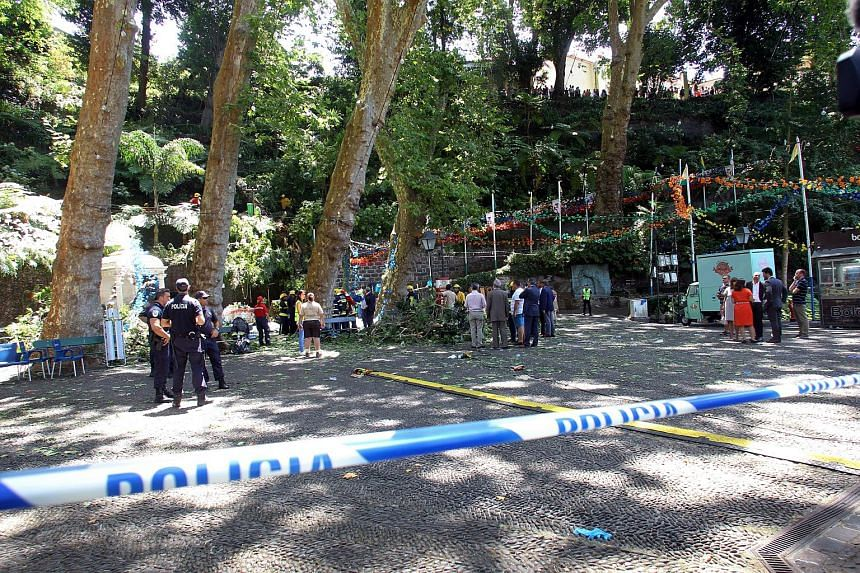 The Police tape secure the site where a large tree fell and injured several people in Largo da Fonte, on Aug 15, 2017.