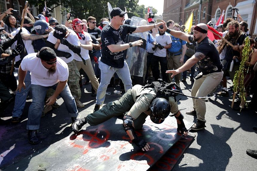 """White nationalists, neo-Nazis and members of the """"alt-right"""" clashing with counter-protesters in Charlottesville, Virginia on Aug 11, 2017."""