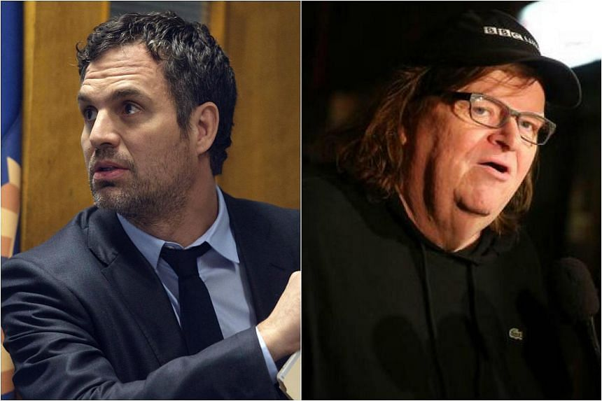 Actor Mark Ruffalo (left) and film-maker Michael Moore took their outrage to the streets outside Trump Tower in Manhattan on Aug 15, 2017.