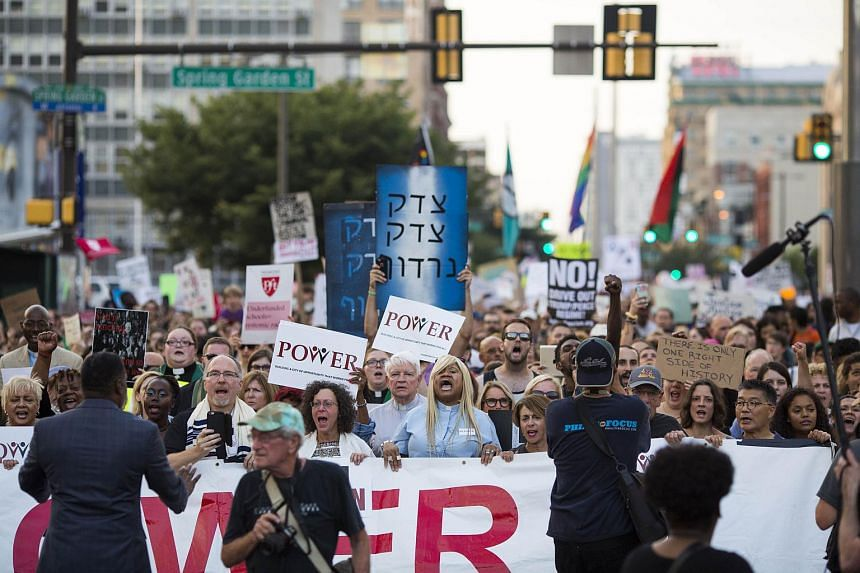Demonstrators participate in a march and rally against white supremacy Aug 16, 2017 in downtown Philadelphia, Pennsylvania.