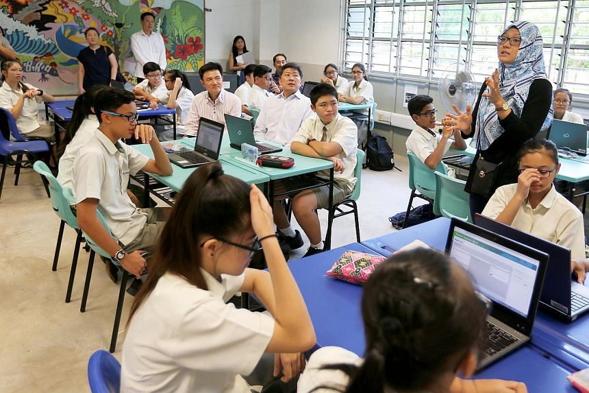 Admiralty Secondary School Principal Mr Toh Thiam Chye and Education Minister Mr Ng Chee Meng, join a Secondary 2 mathematics class with Teacher Ms Khairyn Adriana at the Admiralty Secondary School on Aug 16, 2017.