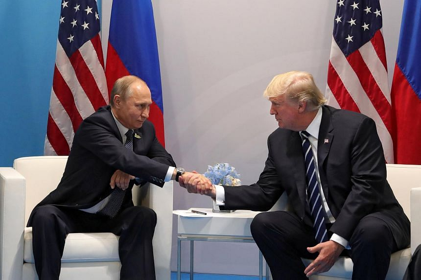 Russian President Vladimir Putin (left) and US President Donald Trump shake hands during their meeting on the sidelines of the G20 summit in Hamburg, Germany.