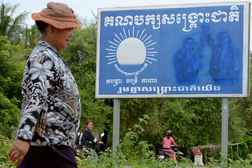 Images of Cambodia National Rescue Party leader Kem Sokha (left) and former leader Sam Rainsy (right) have been scrubbed off billboards across the country, such as this one in a village in Pursat province.