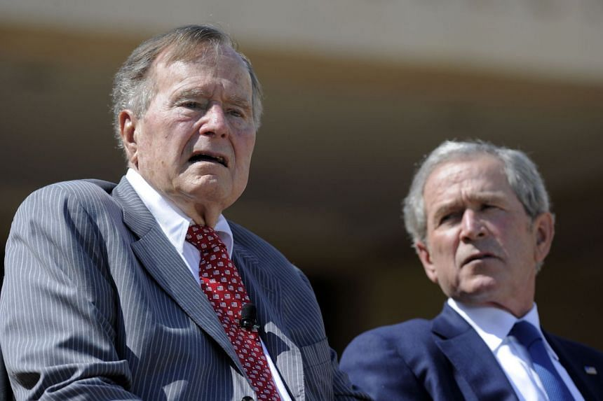 Former US presidents George H.W. Bush (left) and George W. Bush in a 2013 file photo.
