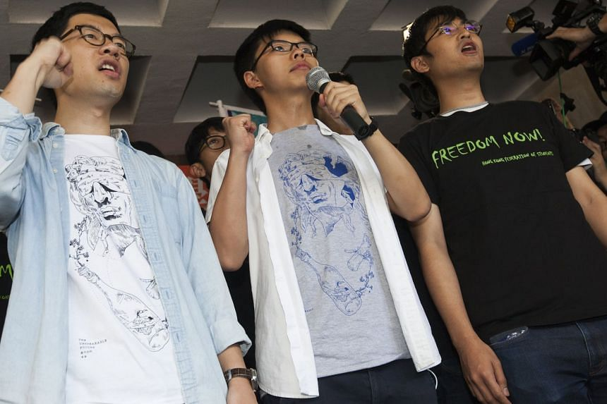 (From left) Activists Nathan Law, Joshua Wong and Alex Chow speaking to the media outside Hong Kong's High Court in Hong Kong on Aug 17, 2017.