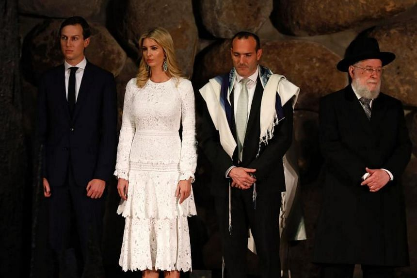 (From left) White House senior advisor Jared Kushner, his wife and the US President's daughter Ivanka Trump, cantor Shay Abramson and Rabbi Yisrael Meir Lau at a wreath-laying ceremony in the Yad Vashem Holocaust Memorial museum in Jerusalem on May 2
