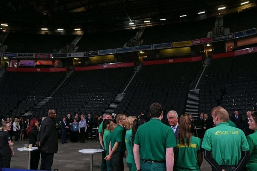 Britain's Prince Charles (fourth from right) meeting medical and security staff at the Manchester Arena on June 26, 2017. The staff had helped the victims of the May 22 bomb attack at the arena.