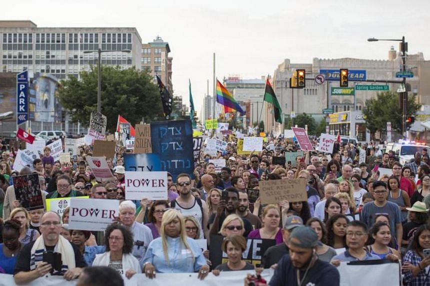 Demonstrators participate in a march and rally against white supremacy on Aug 16, 2017 in downtown Philadelphia, Pennsylvania.