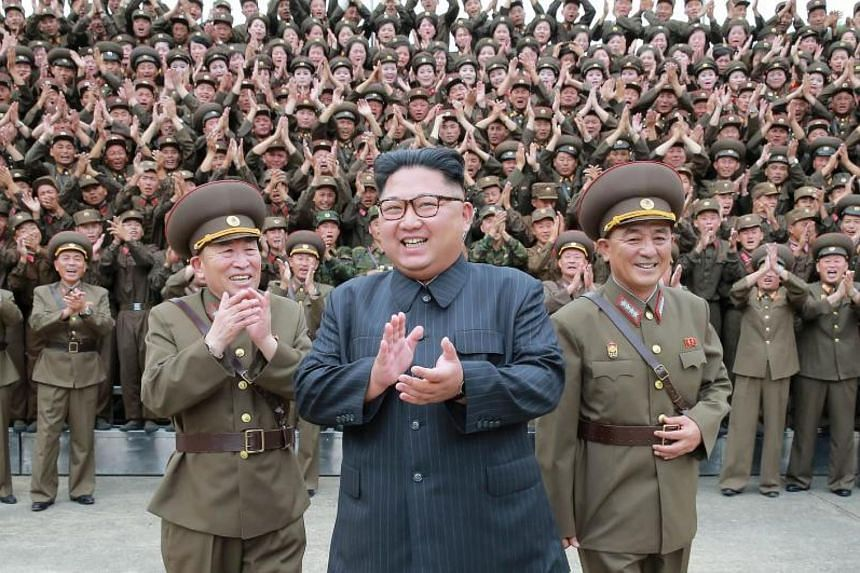 North Korean leader Kim Jong Un (centre) inspects the Command of the Strategic Force of the Korean People's Army at an undisclosed location.