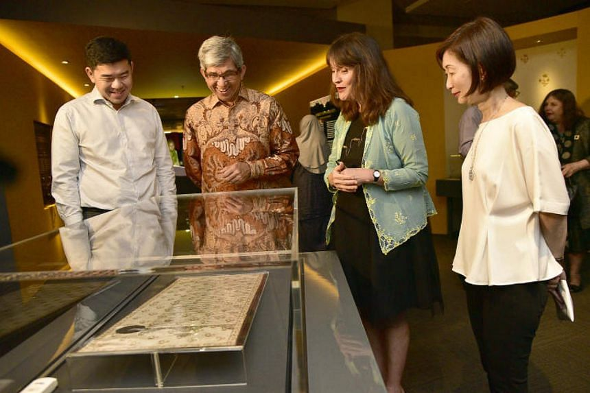 Minister of Communications and Information Dr Yaacob Ibrahim looks at a letter Sultan Syarif Kasim of Pontianak sent to Sir Stamford Raffles in 1811 to request British aid against the sultan of Sambas.