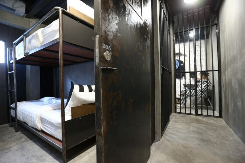Iron bars, bunk beds, narrow rooms and black-out doors create the setting of a prison cell at the Sook Station, Bangkok's first prison-themed hostel.