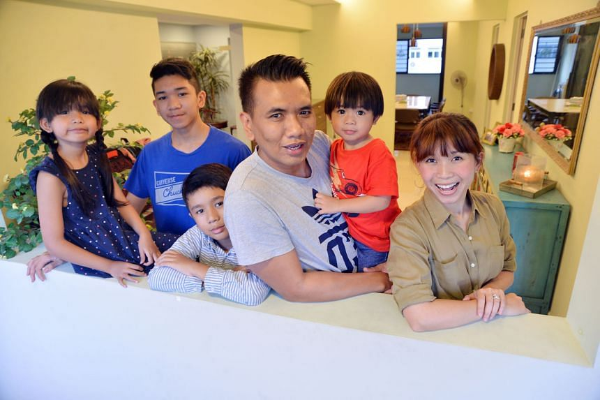Mr Nurul Hatta Takim, with his wife Hafiza Yahya, and children (from left) Eryna Amelia, eight, Haziq Mateen,14, Ryan Zuhayr, 10, and Aydin Ezra, two. Mr Nurul Hatta and Ms Hafiza hacked down a wall and expanded their master bedroom to create their d
