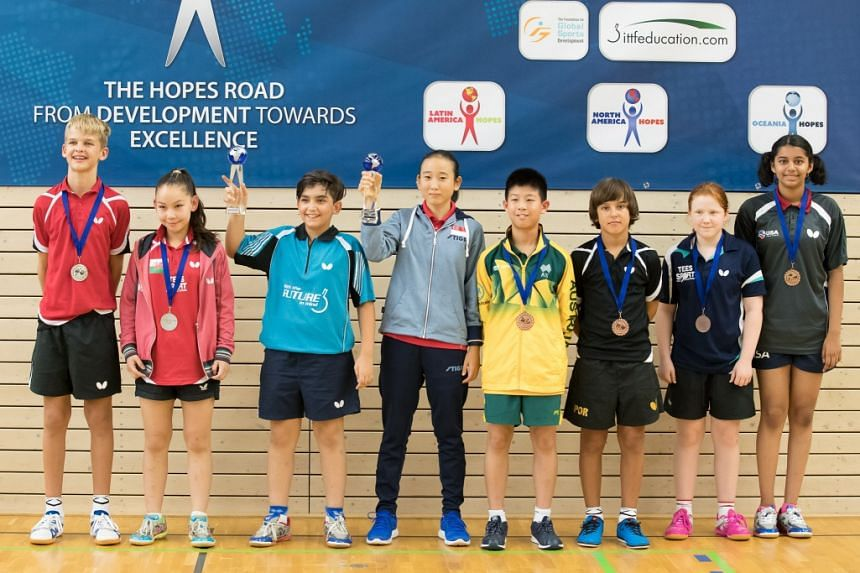 Singapore Zhou Jingyi with her fellow competitors at the ITTF World Hopes Challenge in Luxembourg.
