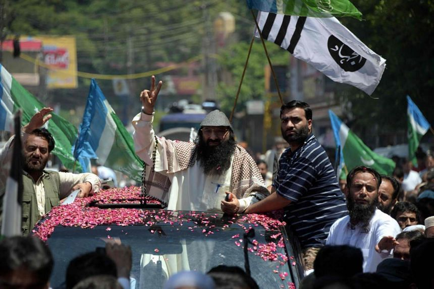 Senior leader of Kashmiri militant group Hizb-ul-Mujahideen Syed Salahuddin gestures as he arrives for a press briefing in Muzaffarabad, on July 1, 2017.
