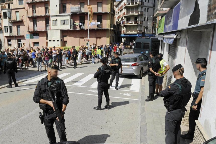 Spanish security forces carry on a rally in a home in the town of Ripoll, Catalonia, on Aug 18, 2017.