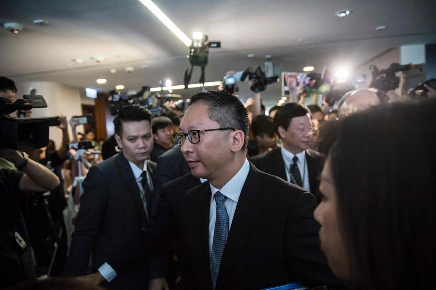 Hong Kong's Secretary for Justice Rimsky Yuen (centre) leaves after a meeting to discuss the high-speed rail link which will connect the city to the southern Chinese city of Guangzhou, at the Legislative Council building in Hong Kong on Aug 3, 2017.