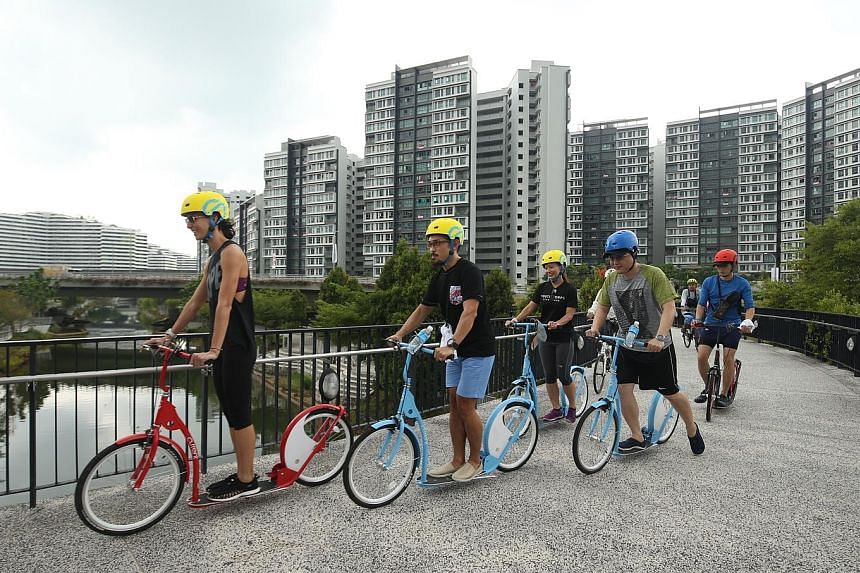 Members of the National Youth Council (NYC) and NYC senior management kickbiking in Punggol Way yesterday. Outward Bound Singapore will be extending its youth expedition activities, which are now conducted mainly on Pulau Ubin, to new areas in Punggo