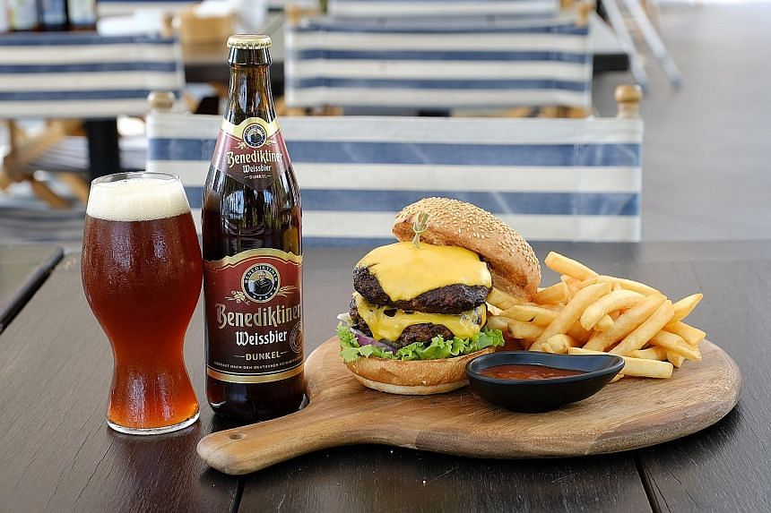 Tiger Black beer with yakitori from gourmet catering company Shiso (above left) and German beer Benediktiner Weissbier with a cheeseburger from American restaurant Handlebar (above right) at Beerfest.