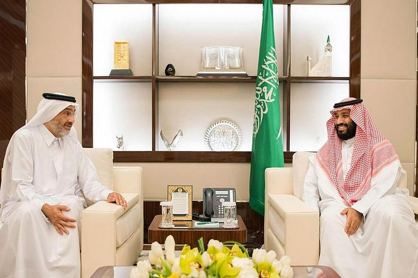 """Saudi Crown Prince Mohammed bin Salman (at right) with Qatari envoy Sheikh Abdullah bin Ali bin Jassim al-Thani in Jeddah on Wednesday. Prince Mohammed emphasised the """"historical relations between Saudi and Qatari people"""" after his meeting with the e"""