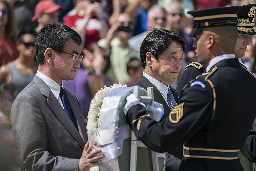 Japanese Foreign Minister Taro Kono (far left) and Defence Minister Itsunori Onodera at a wreath-laying ceremony at The Tomb of the Unknown Soldier in Arlington National Cemetery in Arlington, Virginia, in the United States, on Wednesday. They were s