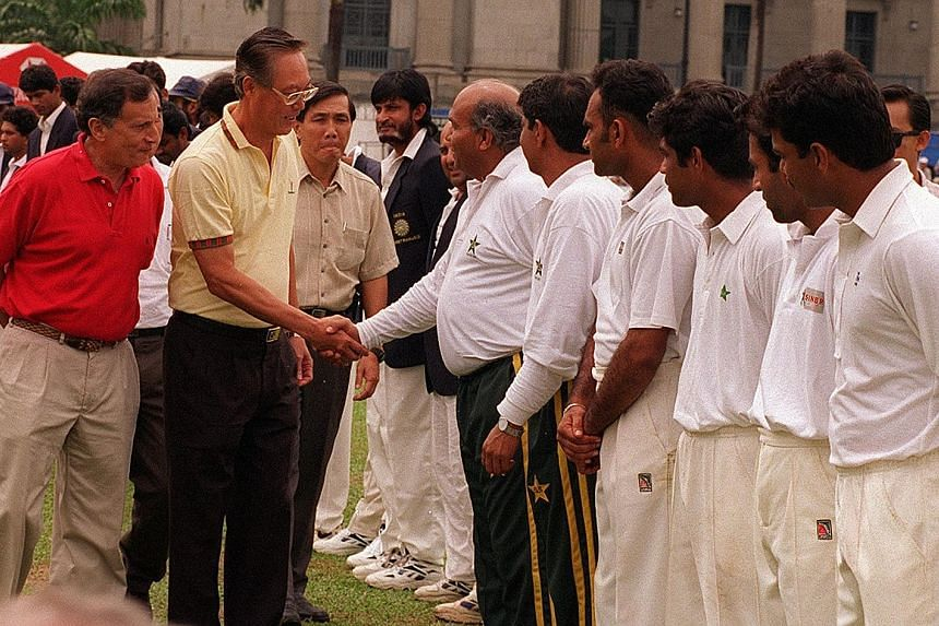 Mr Joe Grimberg (in red) introducing then PM Goh Chok Tong to the Pakistan cricket team manager in 2005, at the Pakistan vs India match at the Singapore Cricket Club.