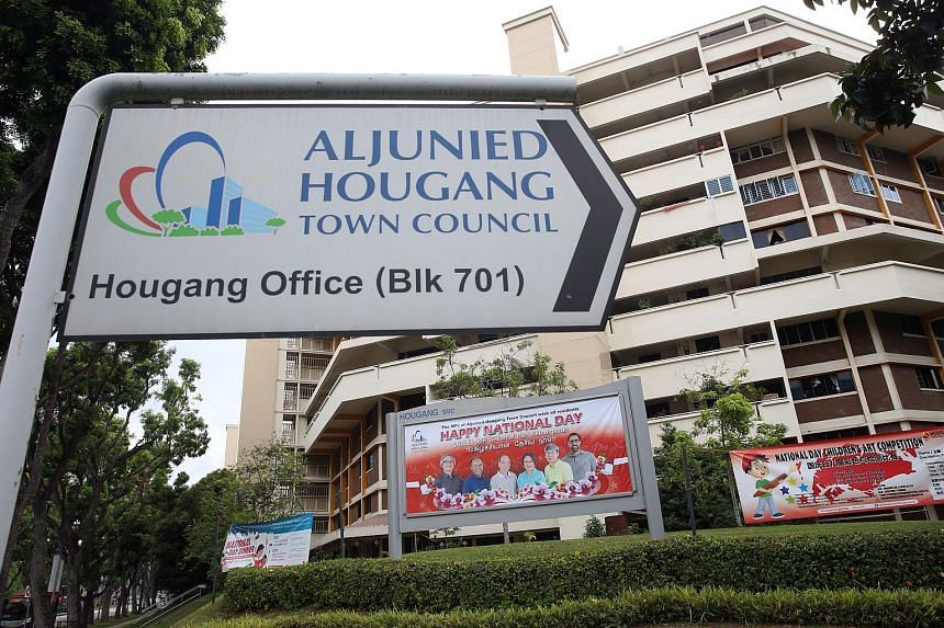 A direction sign for the Hougang office of Aljunied-Hougang Town Council (AHTC) at Block 701, Hougang Ave 2.